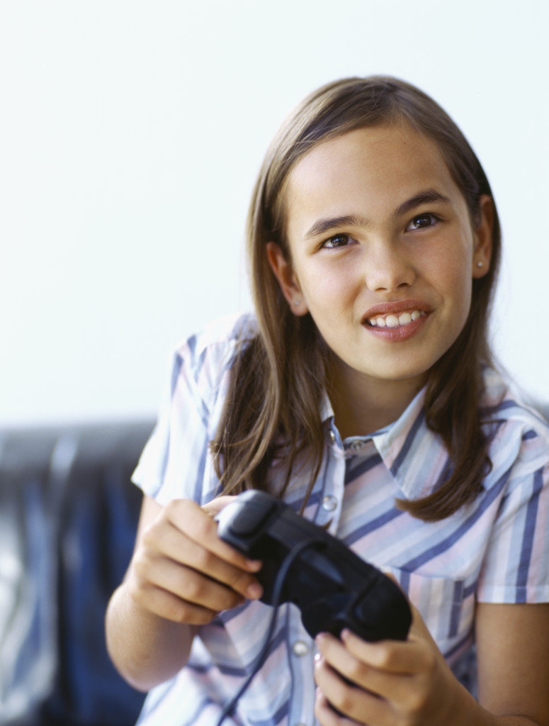 close-up of a girl playing a video game